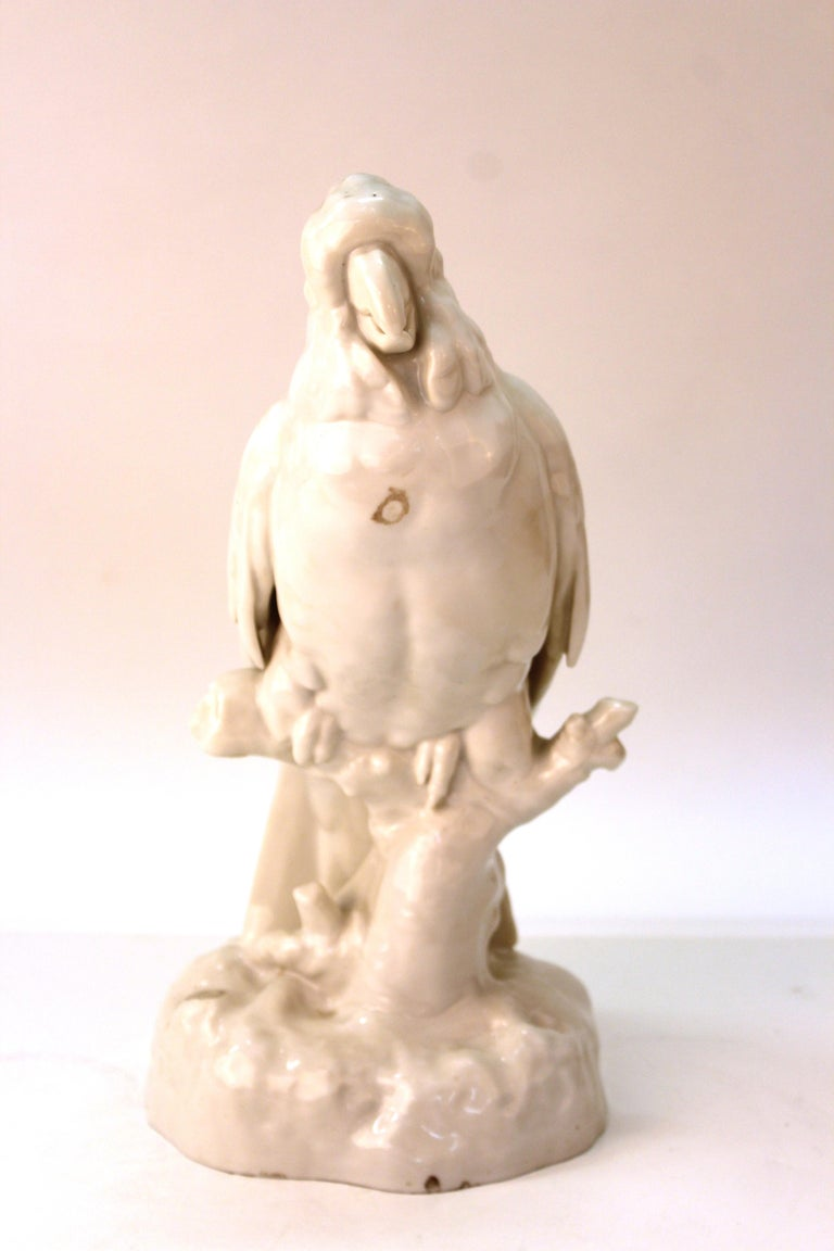 Continental white-glazed porcelain figure of a life-sized cockatoo perched on a branch, possibly German. Unknown makers mark on reverse of base. Several tiny old clam-shell chips, but overall in great antique condition.