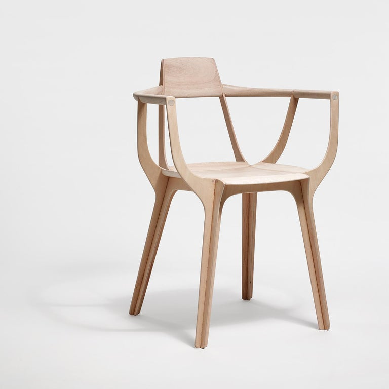 Eutopia has a sophisticated structure: this armchair is made up of four pieces of multi-laid wood that intersect and then separate again in the seat, allowing different planes to work in their own forceful directions to hold the seat and the