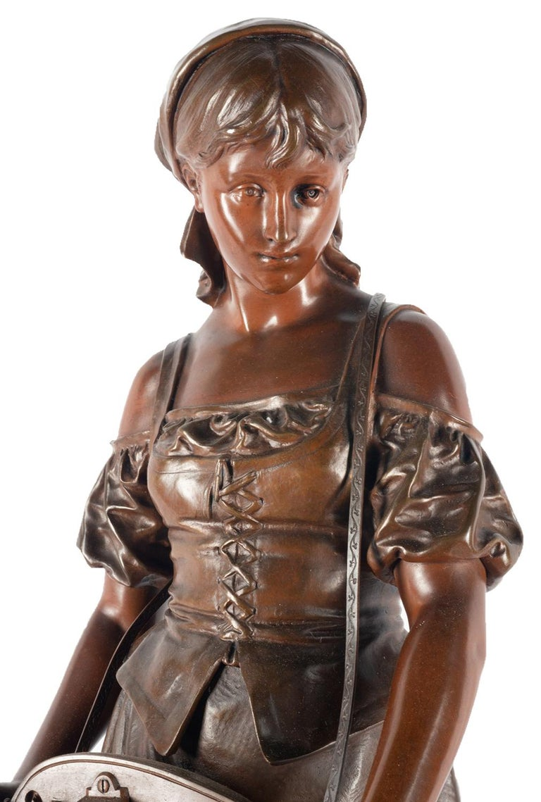A very good quality 19th century patinated bronze statue of a gypsy girl 'Tuning the Mandolin' Signed; Bouret. Eutrope Bouret (16 April 1833 in Paris – 1906) was a 19th century French sculptor. Eutrope Bouret was a student of Louis Buhot. He