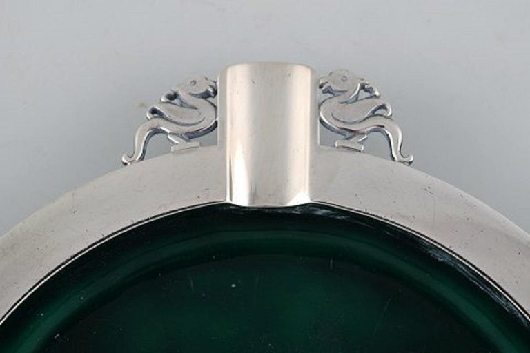 Evald Nielsen (1879-1958), Denmark. Art Deco cigar ashtray in sterling silver forged with duck motifs. Inside decorated with green enamel. Dated 1951.