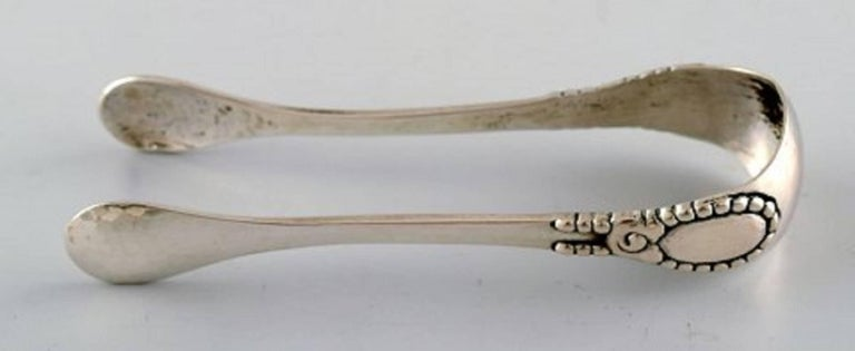 Evald Nielsen number 13, sugar tongs. Measures 12 cm. Stamped, 1920s, Denmark. In perfect condition.