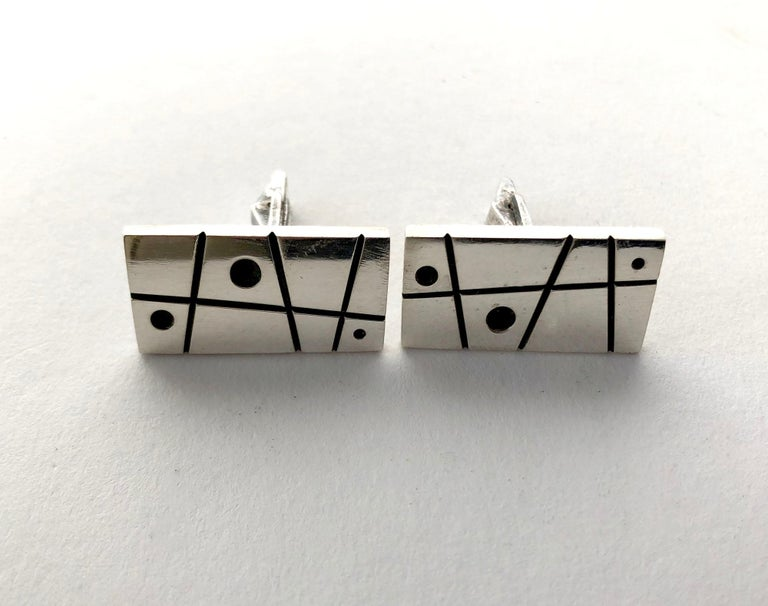 Sterling silver cufflinks created by Everett Macdonald of Laguna, California.  Cufflinks measure 5/8