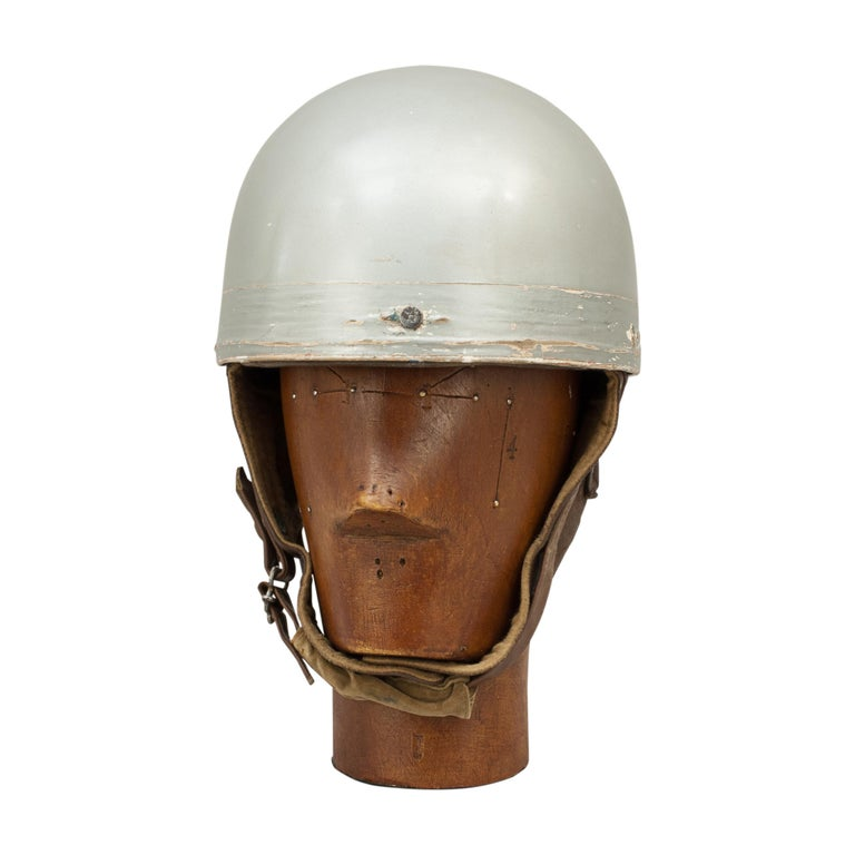 Vintage A.C.U. motorcycle racing crash helmet, Everoak. A fine silver painted motorcycle helmet made in England by Everoak. This helmet has a cork interior, fitted with a leather headband and straps keeping a space between the head and outer case