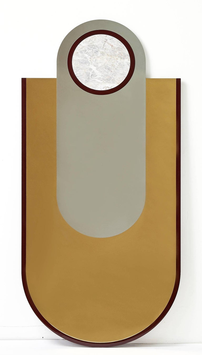 Circle and oval forms unite to create the graphic everything is golden mirror series.   No. 7 features a glossy black lacquered frame, inset with gold and silver mirrored stainless steel and Grigio Carnico marble.  Keyhole fixings to rear allow