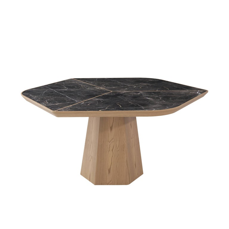 The classic elegance of marble combined with sophisticated details make the Evolve table a genuine piece of sculpture.   Also, Evolve dining table has won 'Good Design Award' in Design Turkey, 2017.