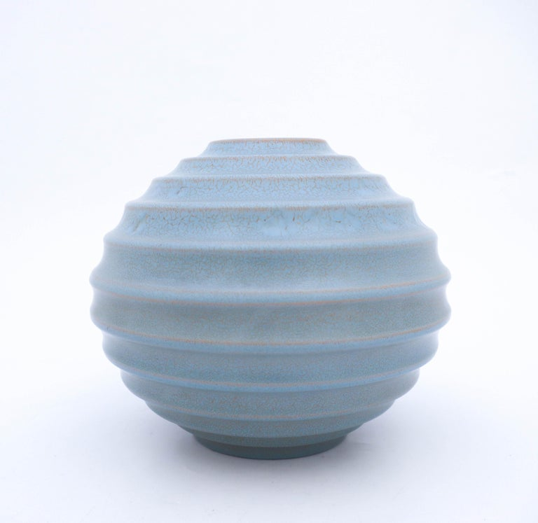 A globose vase designed by Ewald Dahlskog at Bo Fajans in Gefle in the 1930s. This vases was first presented at the Stockholm exhibition in 1930, that was the start for the functionalism. The vase has a lovely glaze that is called Turquoise. The