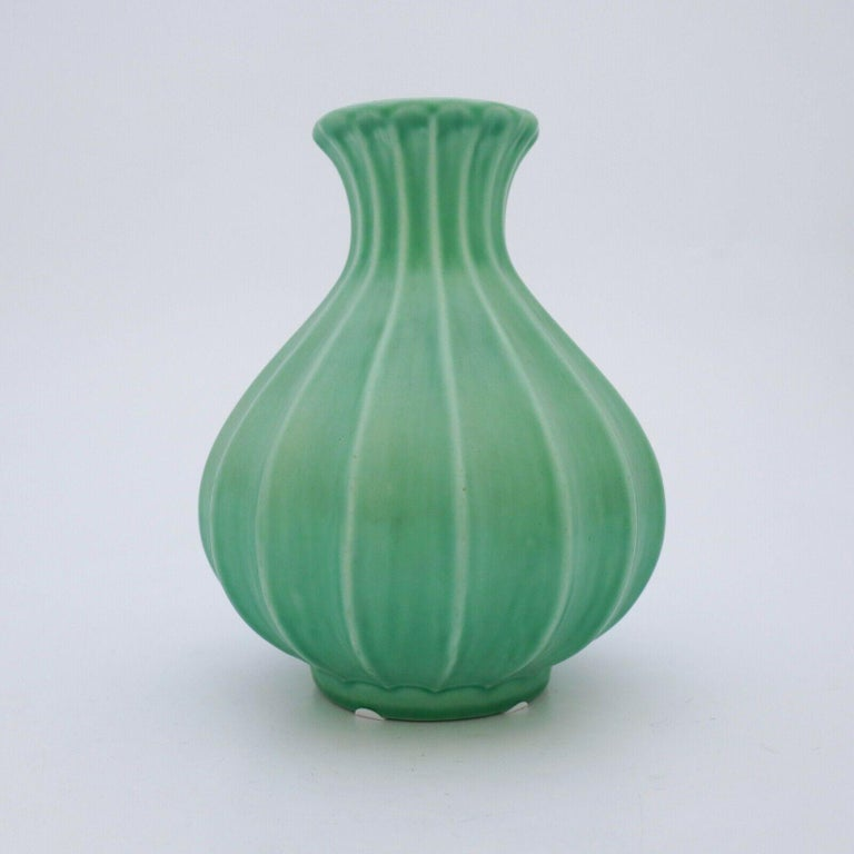 A beautiful green vase designed by Ewald Dahlskog at Bo Fajans in Gefle in the 1930s. The vase is 18.5 cm high. And it is in very good condition.