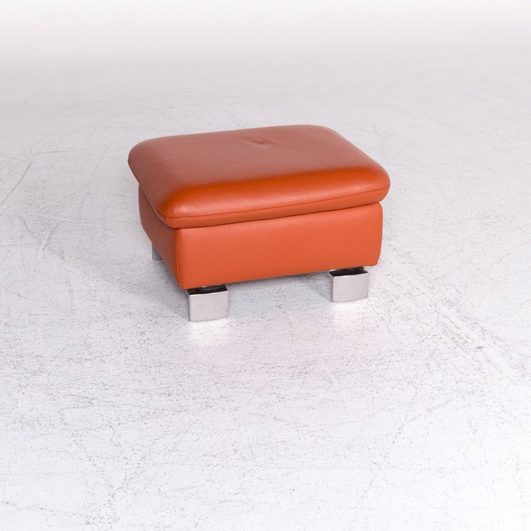 We bring to you an Ewald Schillig designer leather stool orange function storage space.  Product measurements in centimeters:  Depth 55 Width 66 Height 43.