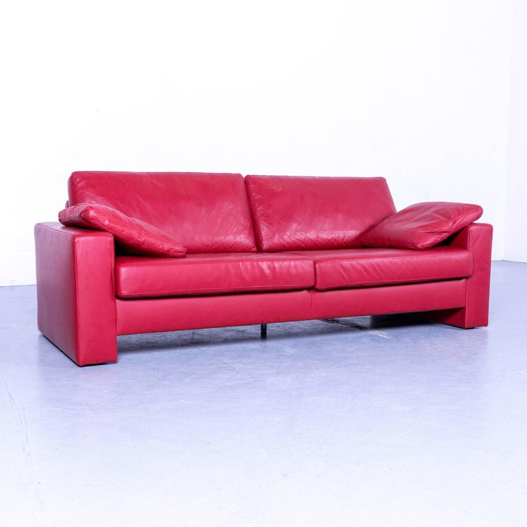 An Ewald Schillig designer three-seat sofa red leather couch.