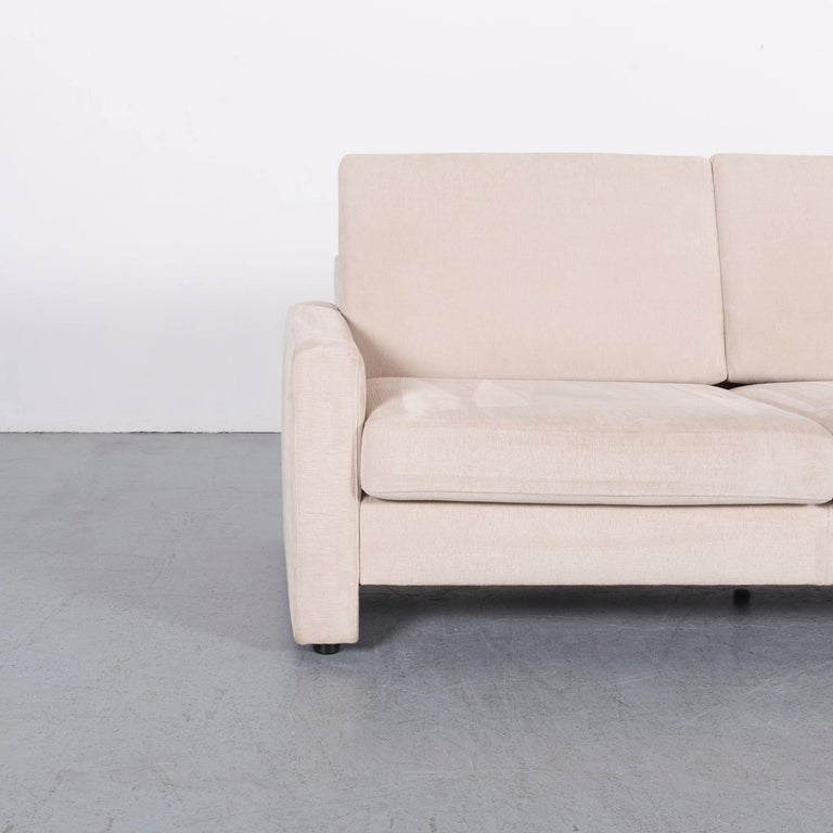 We bring to you an Ewald Schillig fabric sofa off-white two-seat couch.