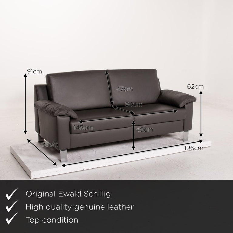 We present to you an Ewald Schillig leather sofa gray three-seat couch.       Product measurements in centimeters:    Depth 95 Width 196 Height 91 Seat height 49 Rest height 62 Seat depth 54 Seat width 145 Back height 47.