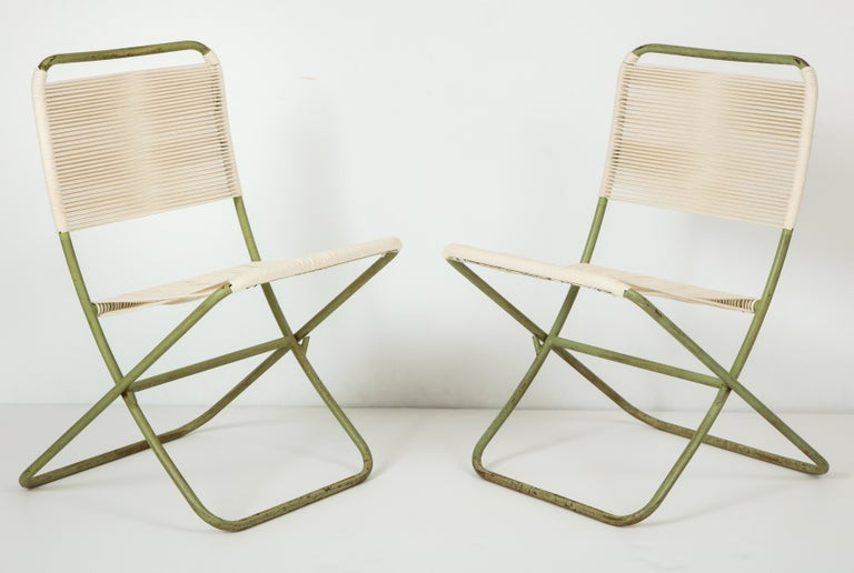 Exceedingly rare, sculpturally resonant Greta Grossman indoor/outdoor folding chairs, of painted tubular steel and cotton cord, produced in California circa 1949 either by Barker Brothers or Modern Color, Inc. The chaise and lounge versions of this