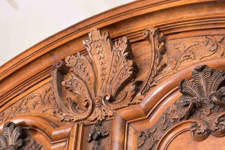 Beautifully carved 18th century walnut armoire with original shelves, hardware and keys. The patina and depth of carving make this armoire a standout.