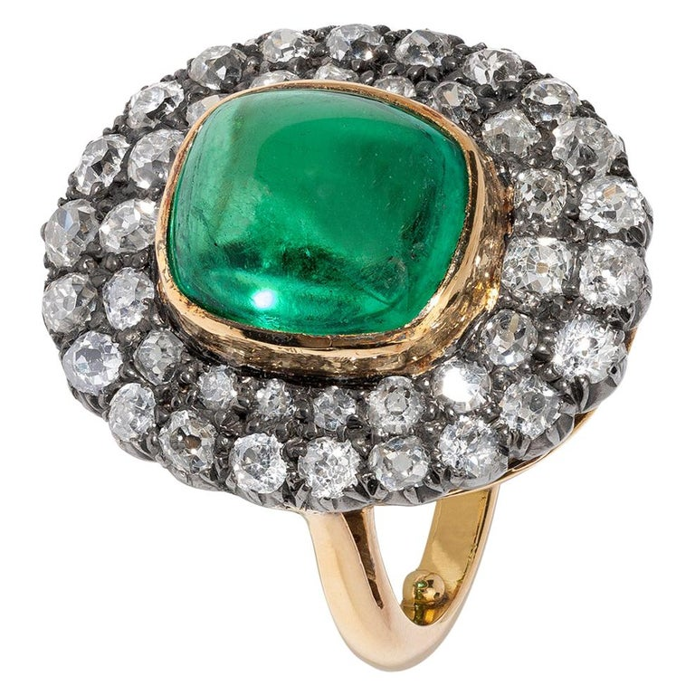 Exceptional 7.12 Carat Cabochon Emerald and Diamond Ring For Sale