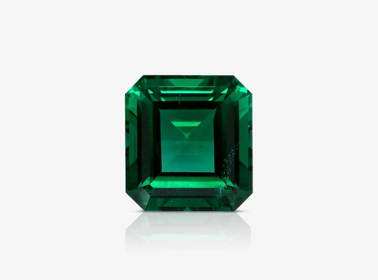 Antinori Fine Jewels, Showcasing a stunning certified 5.03 carat center emerald.   This emerald is super rare being untreated, No Oil, Vivid green color please take a look closely to this emerald is not only AAA+ in color and clarity because it has