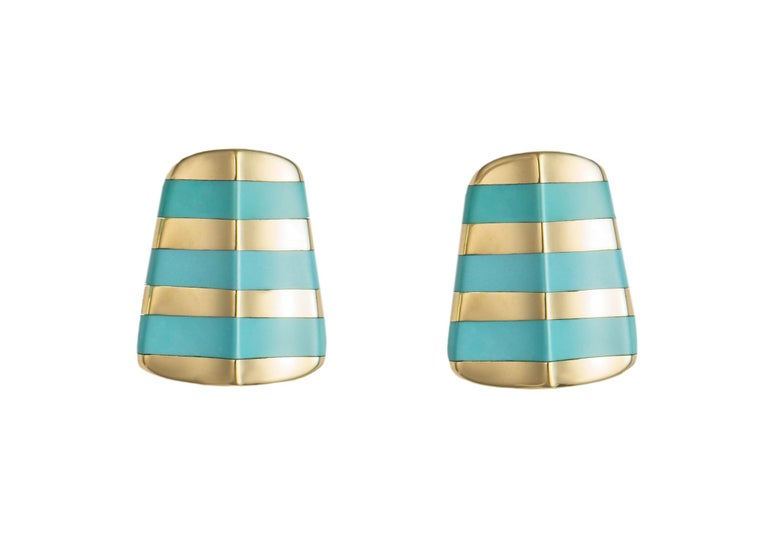 Angela Cummings began her career at Tiffany & Co. before starting her own highly successful company. Her unique designs are iconic and collectable. This banded turquoise and gold design is rare and highly prized.