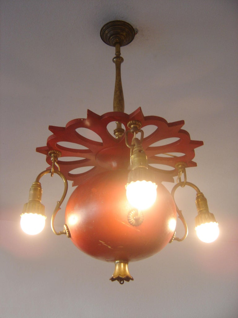 Extremely rare, original Art Nouveau chandelier or pendant lamp 'Granate Apple'. Manufactured about 1900s, Berlin, Germany.  Executed in wood and brass, the chandelier comes with 4 x E14 / E12 Edison screw fit bulb holders, is wired, and in