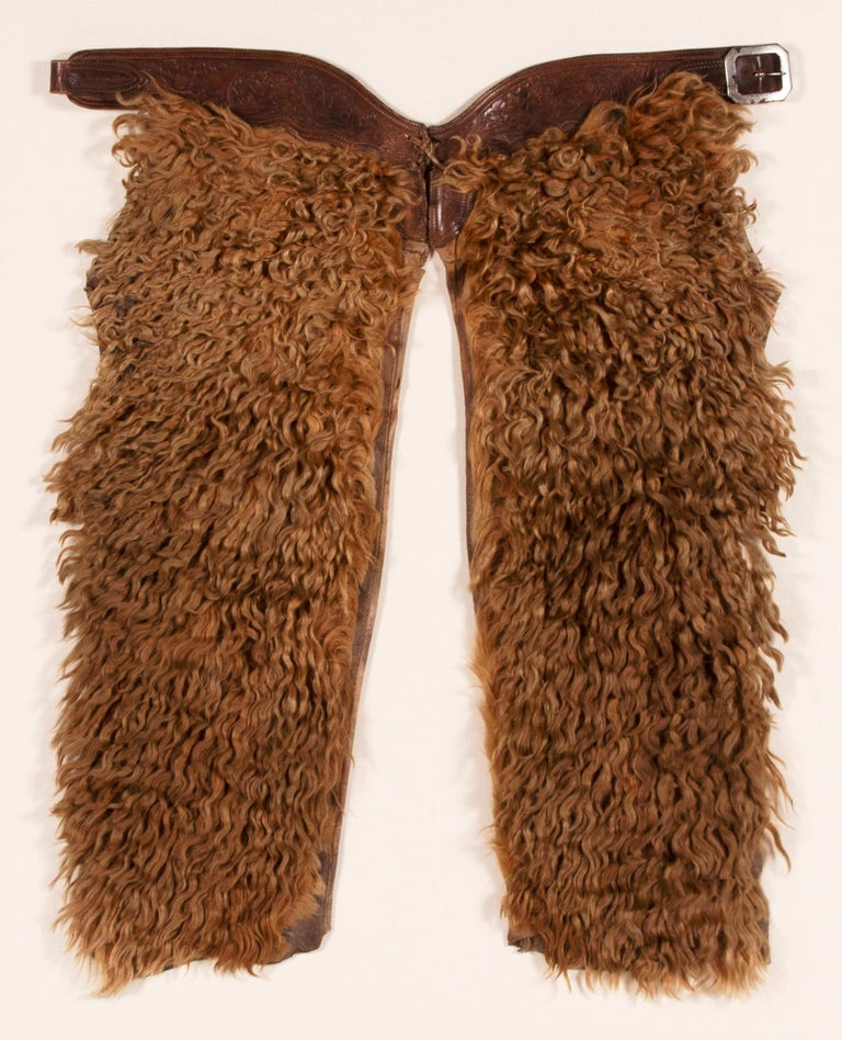 Exceptional, blonde, wooly, angora chaps, Circa 1880-1920  Wooly chaps made of leather and canvas, faced with dyed Angora, unsigned, but beautifully graphic and of exceptional quality. The blonde color, scale, and state of preservation are of