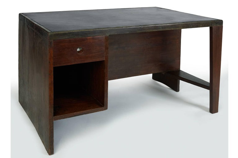 Pierre Jeanneret (1896–1967)  An exceptional floating desk with gracefully arched legs and a harmoniously integrated pigeonhole bookcase on the reverse, by Pierre Jeanneret for the Administrative Buildings in Chandigarh, India, designed by Le