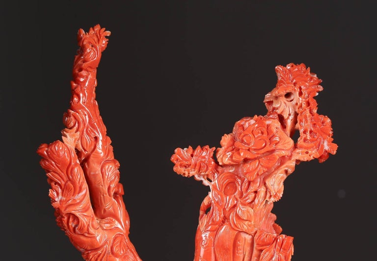 An exceptional Chinese carved coral figural group of immortals  Very finely carved. With original wooden base.  Measures: Coral: 11.5