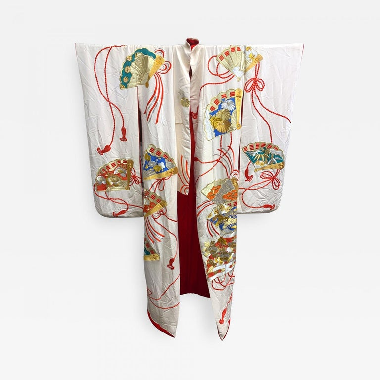 A visually striking vintage Uchikake Wedding Kimono/Robe for ceremonial occasion, circa 1930s-1940s in the Oriental Art Deco style. The bridal garment of a cream white silk features elaborate and intricate embroidery of motifs of highly decorated