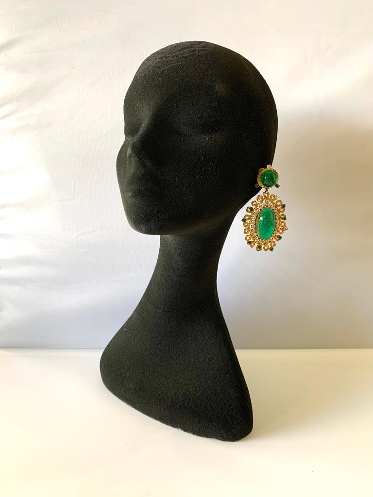 Exceptional vintage large faux emerald and diamante drop clip-on statement earrings - the statement earrings are comprised out of hand-manipulated gilt metal and feature an ornate design which is accented by diamante and emerald diamante rhinestones