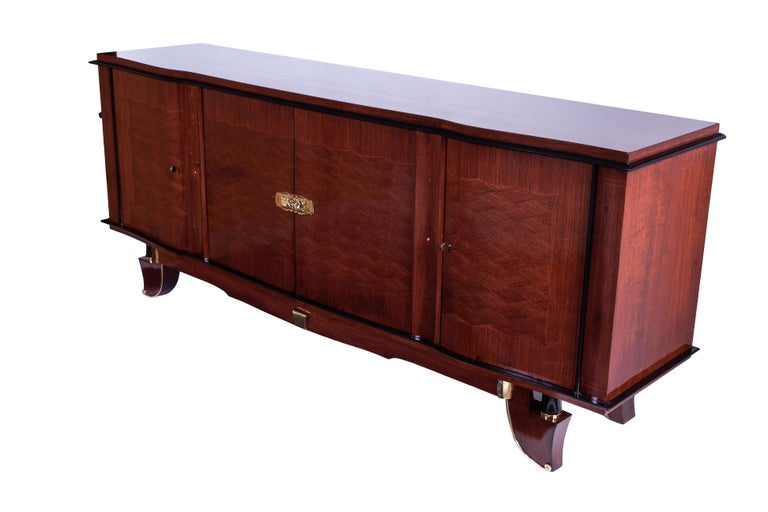 A grand French Art Deco palisander buffet by J. Leleu with mother of pearl inlay, marquetry and polished brass hardware. Interior veneered in sycamore.