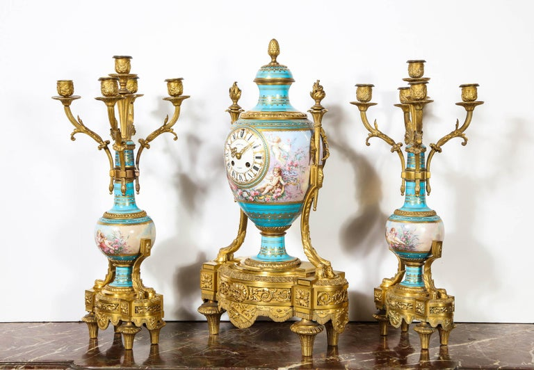 An exceptional French bronze ormolu mounted turquoise jeweled Sèvres Porcelain clock set by Raingo Fres Paris, circa 1880.