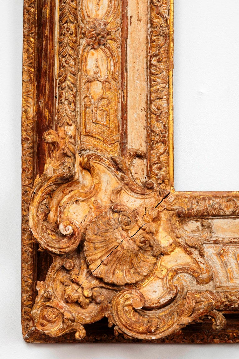 Rare and exceptional French Regence period carved and giltwood mirror / frame France, circa 1720. Extraordinary carving and scraped gilding The extraordinary quality of carving and scraped gilding (in fashion for impressionist paintings) makes it