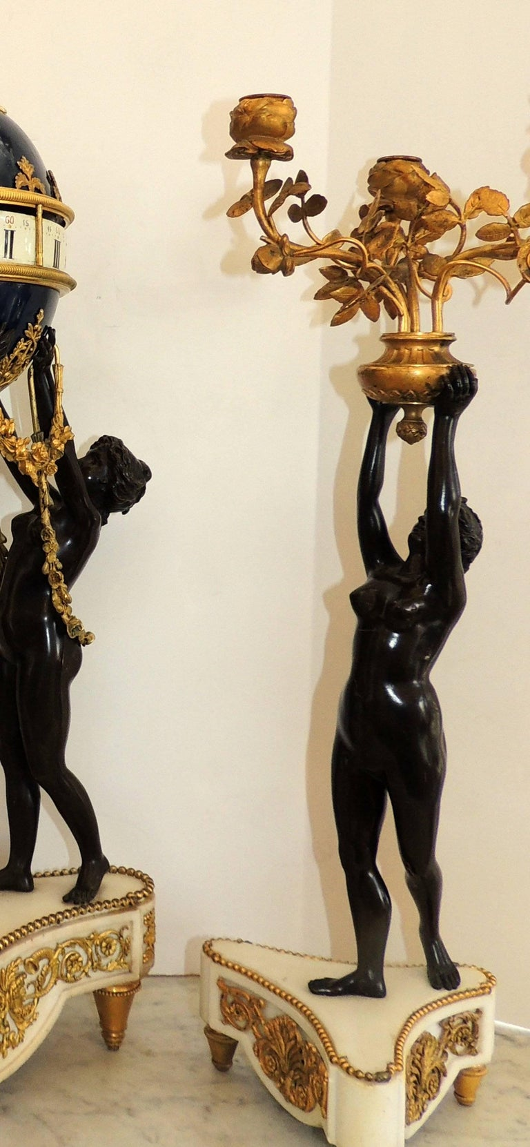 Gilt Exceptional French Three Graces Piece Rotary Mystery Clock Set Candelabra Suite For Sale