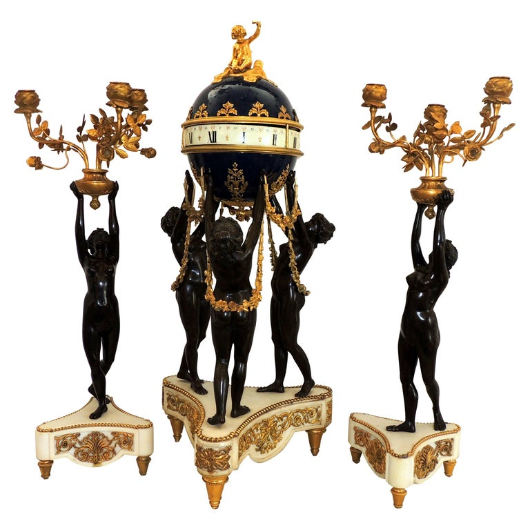 Exceptional French Three Graces Piece Rotary Mystery Clock Set Candelabra Suite For Sale