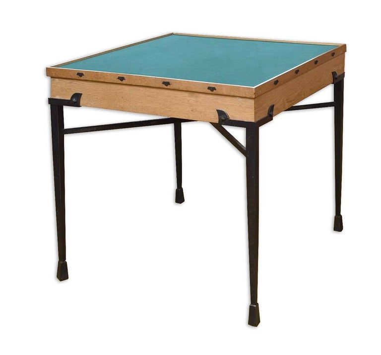 Exceptional set by Etienne Kohlmann containing one game table and three armchairs. Black lacquered iron and leather for the chairs and black lacquered iron, oak and green velvet for the game table. Measures: Game table: 29