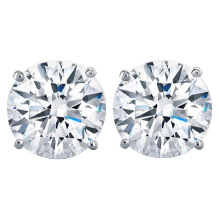 GIA Certified 6.02 Carat VVS1/SI1 Clarity H Color Diamond Studs For Sale