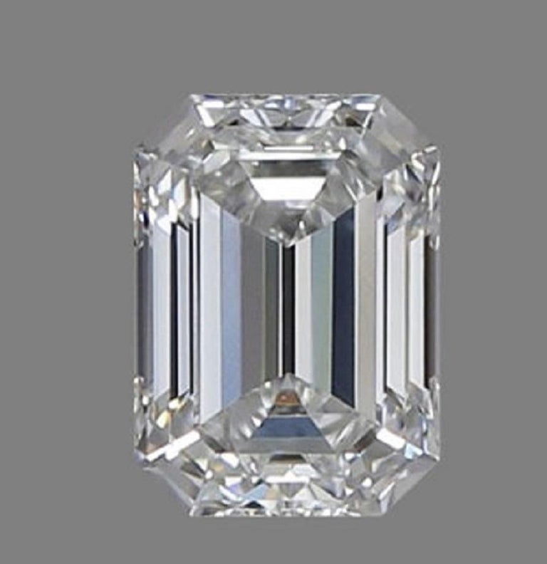Modern GIA Certified 4.63 Carat Emerald Cut Diamond Ring G Color VVS1 Clarity For Sale