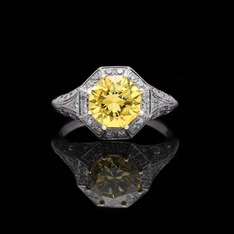 Art Deco Exceptional GIA Fancy Intense Yellow Diamond in French Platinum Ring