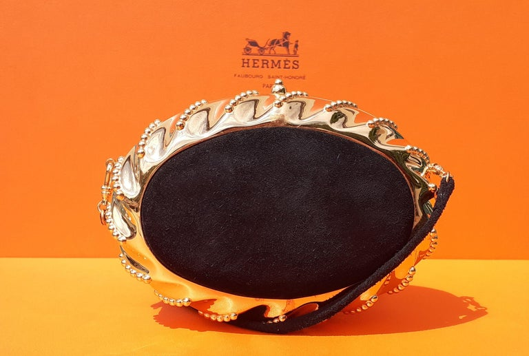 Super Cute Authentic Hermès Evening Bag  Made in France  Probably vintage, no stamp  Made of Doblis Leather and Golden Hardware  Inside lined with smooth Leather  Colorway: Black, Golden