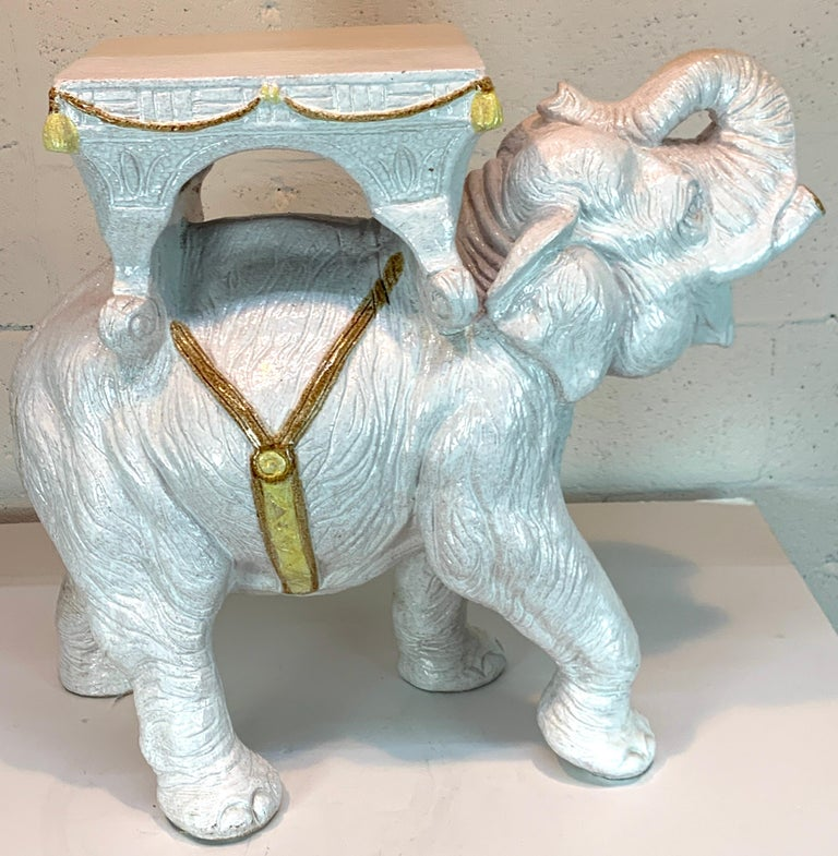 """Exceptional Hollywood Regency white parade elephant garden side table, Italy Highly detailed, with trimmed tusks, and raised right foot and trunk upwards, fitted with a 10"""" x 11"""