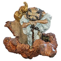 Exceptional Japanese Ceramic Figure in Knotted Wooden Stand