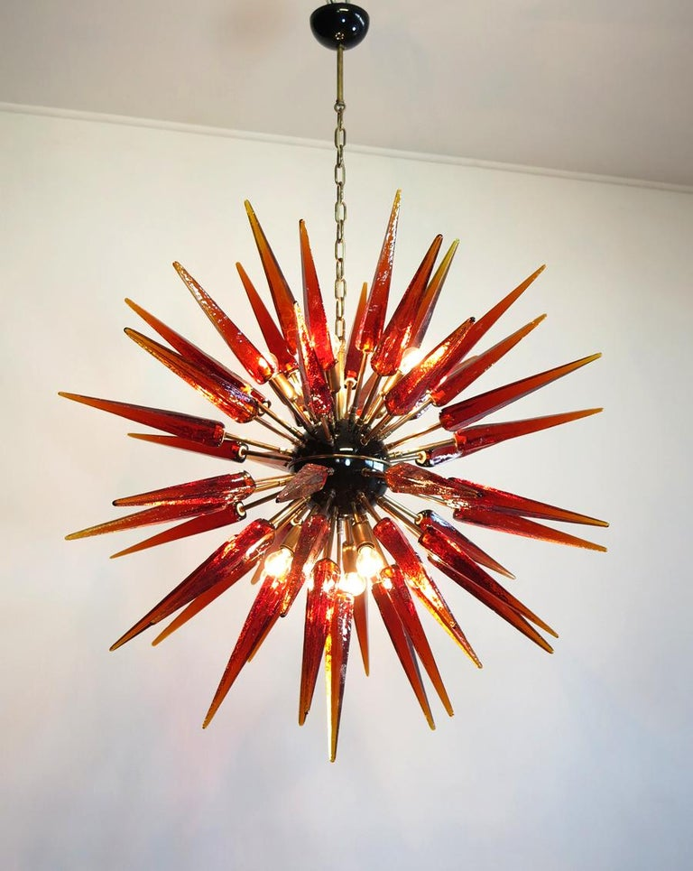 Italian Sputnik chandelier in a black and brass metal, 51 unobtainable amber glass tips. Murano blown glass in a traditional way. 10 light points. Period: late xx century Dimensions: 55,10 inches (140 cm) height with chain; 37,40 inches (95 cm)