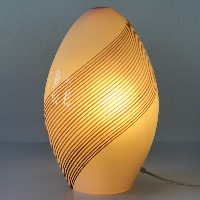 Extremely rare, large Mid-Century Modern Murano glass table lamp. Designed by Lino Tagliapietra for Effetre International Company, Italy, 1980s.  This table lamp is executed in thick Murano glass and needs an Edison screw fit E14 bulb. The lamp is
