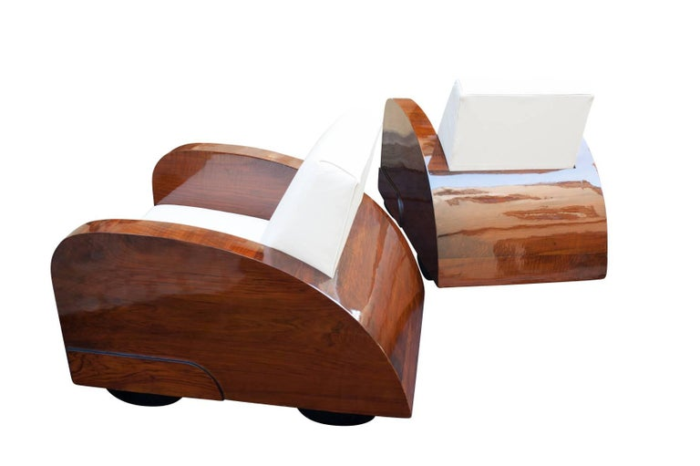 Original 1920s Art Deco club chairs built in the shape of two cars.