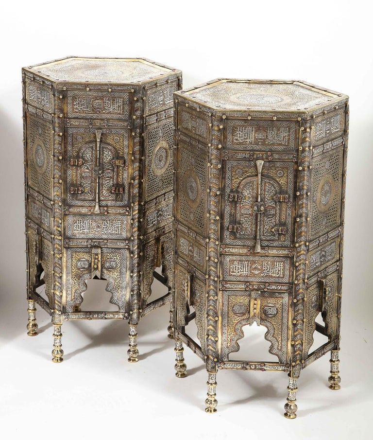 An exceptional and rare pair of Islamic Mamluk Revival silver and copper inlaid Quran Koran side tables, Damascus Syria, circa 1930s  Fully silver inlaid cairoware tables. Very decorative with Arabic calligraphy throughout. Similar ones in museums
