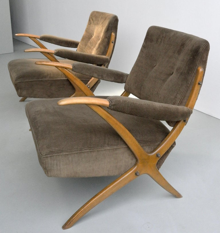 Exceptional cross-frame wooden lounge chairs, Italy, 1950s. For the touch we kept the original upholstery from this rare pair of lounge chairs. Imagine these with a velvet-abundant upholstery, suitable in any midcentury or modern interior.