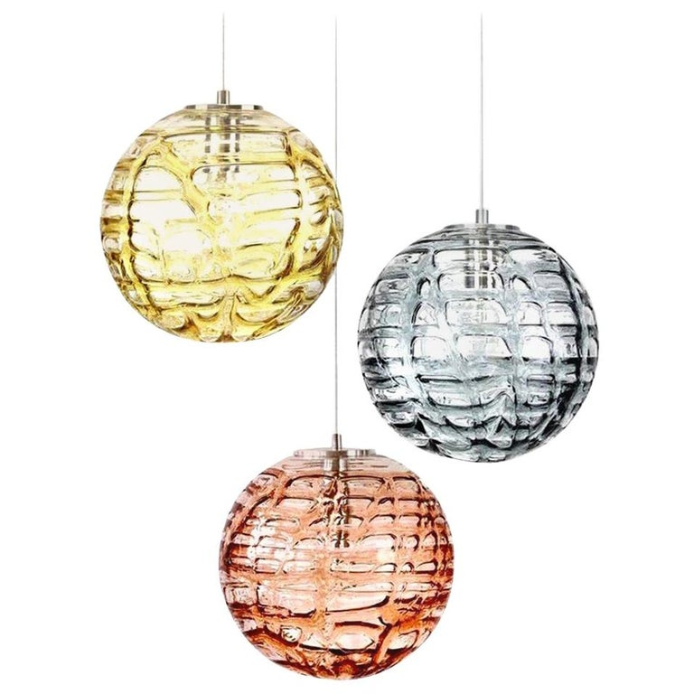 Set of 3 Doria pendant lights (in collaboration with Murano) in the style of Venini, manufactured, circa 1960. Real statement pieces. High-end thick Murano crystal glass shade made out of overlay glasses of different colors (pink, amber, grey)