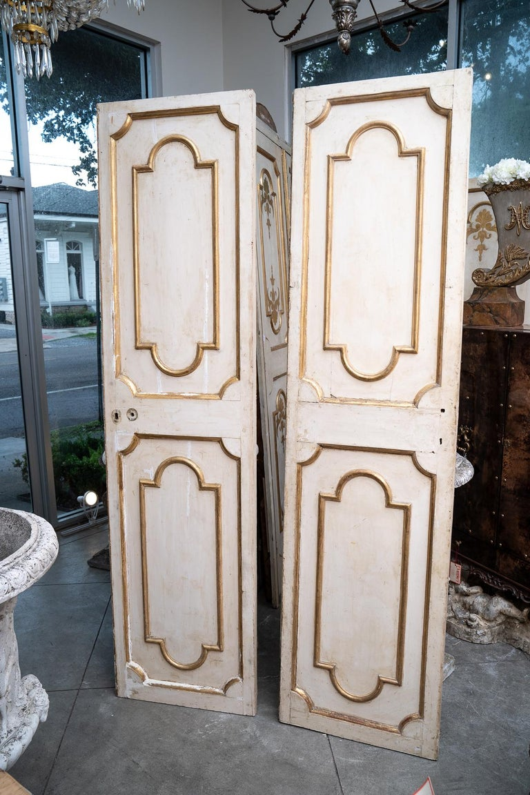 3 sets of 19th century Italian gilded and painted interior doors-some with original hardware.