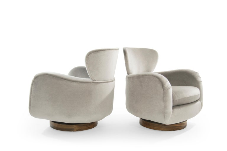 Important set of Vladimir Kagan for Directional pair of stylized wingback lounge chairs and ottoman. Sumptuously designed with enveloping curves and a large horned neck. Newly upholstered in Great Plains