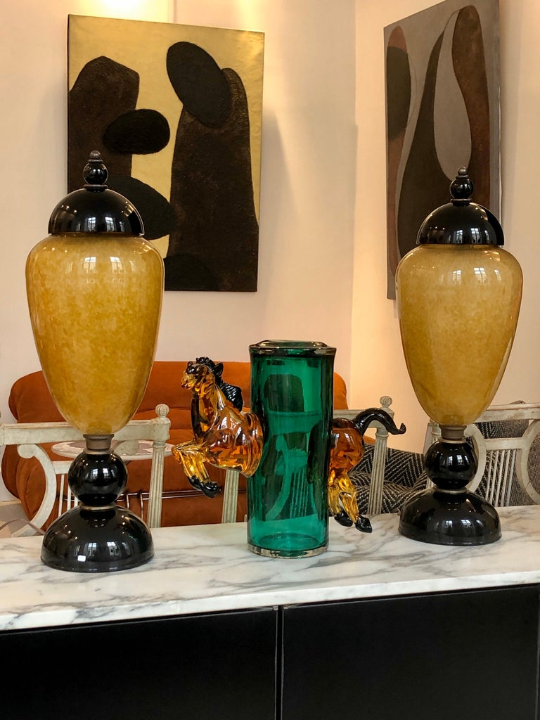 This green emerald and amber Murano glass vase jumping Horse is more than a vase, a is a splendid sculpture! For a horse lovers this master piece on a top of a consol in your entry will be an eye catcher  As you see in the picture number 8 the leg