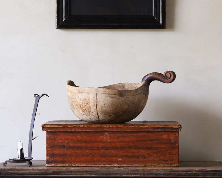Exceptional early 18th century bowl / ale scoop with unusual figured handle, ca 1720 Sweden.