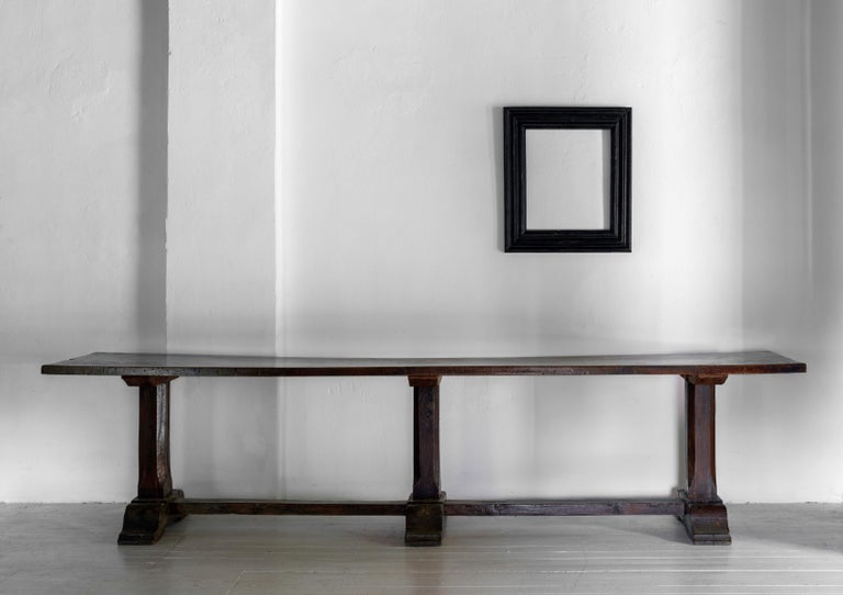 An exceptional 17th century Italian convent table. The top is a single chunky plank of Walnut with perfect patina. A heavy, beautifully patinated table with great visual impact. Timeless and works in almost any setting.
