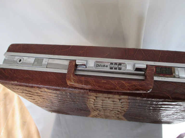 Collectors-item Rare hard-sided attache case made of brown hornback crocodile skin with silver hardware. Interior is leather with pockets and with hidden combination locks. Marked:  Globe Measurements: 43 cm x 31 cm x 9 cm Please note that vintage